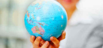 Business woman holding a globe in the hand, focus on globe