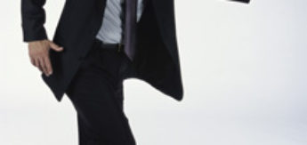 Side profile of a businessman dancing