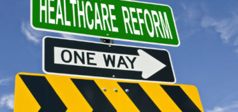 healthcare reform one way post sign over blue sky