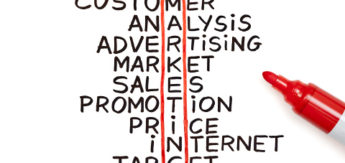 The word Marketing highlighted with red marker in a handwritten chart
